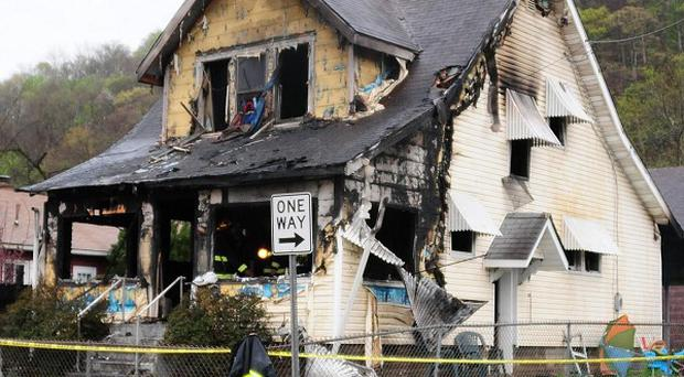 Authorities say six children and two adults died in the fire (AP/Jerry Waters)