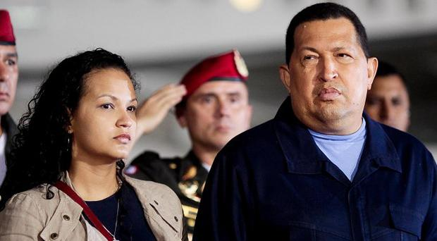 Venezuela's president Hugo Chavez with his daughter Rosa Virginia before they flew to Cuba (AP)