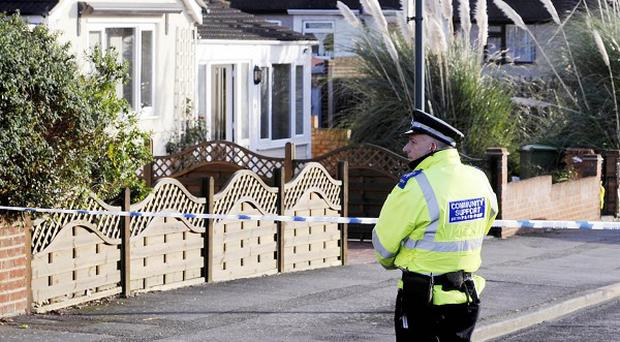 A police community suppoert officer stands near to the home of Edward Syrad in Barnehurst, south-east London, where he died