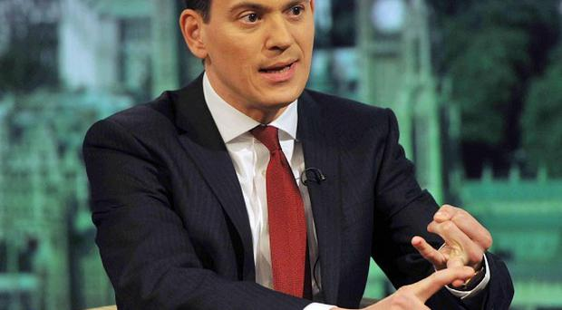 David Miliband says he is 'completely behind' his brother Ed's leadership of the Labour Party