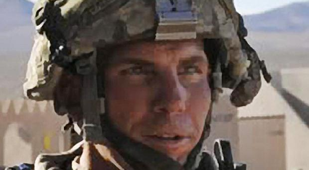 Staff Sgt Robert Bales has been charged with the murder of 17 Afghanistan civilians (AP)