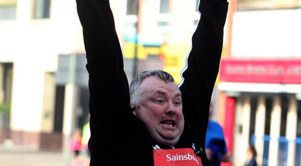 BBC presenter Stephen Nolan crosses the finish line