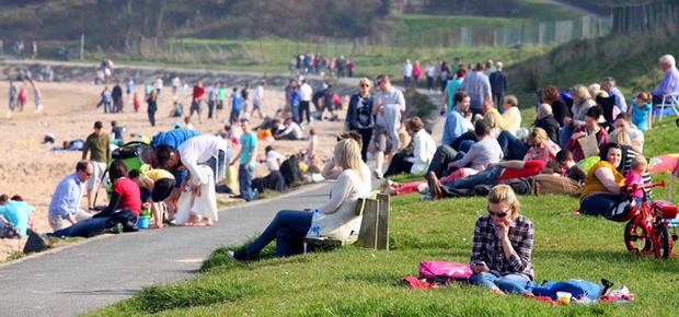 Families enjoy the sun at Helen's Bay on the Co Down coast.
