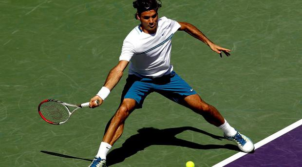 KEY BISCAYNE, FL - MARCH 24: Roger Federer of Switzerland returns a shot to Ryan Harrison during the Sony Ericsson Open at the Crandon Park Tennis Center on March 24, 2012 in Key Biscayne, Florida. (Photo by Matthew Stockman/Getty Images)
