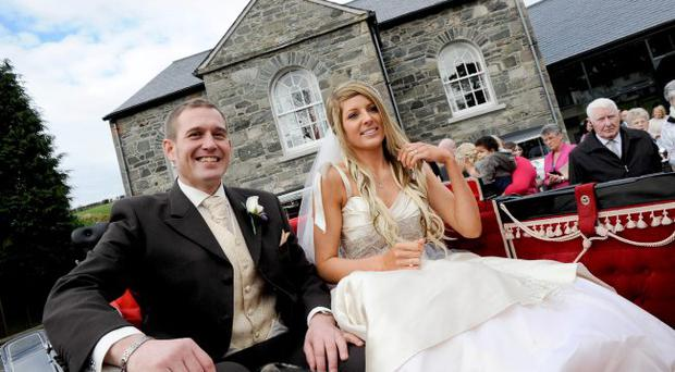 Big day: Desi Gibson and Victoria McKibben were all smiles outside Edengrove Church in Ballynahinch. <p><b>To send us your Wedding Pics <a href=