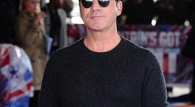 Simon Cowell found an intruder in his west London home