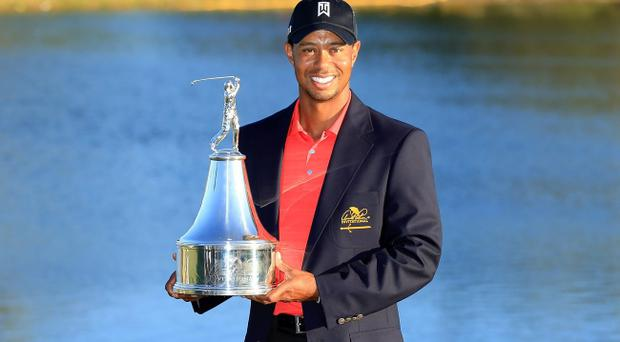 ORLANDO, FL - MARCH 25: Tiger Woods of the USA proudly holds the trophy