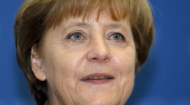 German Chancellor Angela Merkel said the crisis in the eurozone was not over (AP)