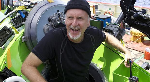 James Cameron emerges from the Deepsea Challenger submersible after his successful solo dive to the Mariana Trench (AP/National Geographic)