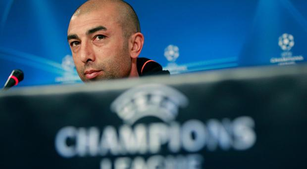 Chelsea's coach Roberto Di Matteo, from Italy, listens to questions during a news conference Monday, March 26 2012, at Benfica's Luz stadium in Lisbon. Benfica will play Chelsea Tuesday in a Champions League quarter-final soccer match