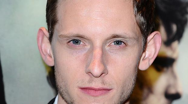Jamie Bell was spotted wearing a band on his ring finger