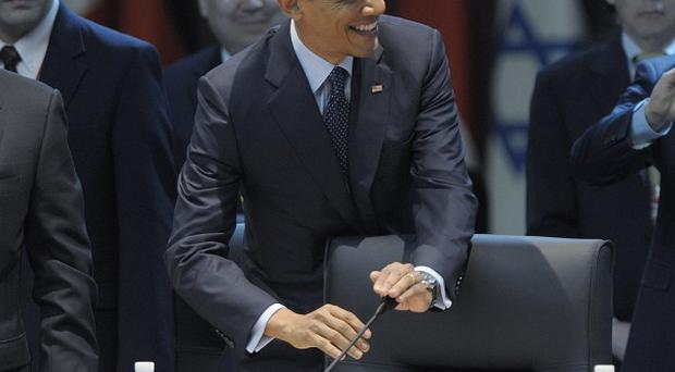 Barack Obama covers the microphone as he arrives at the Nuclear Security Summit in Seoul, South Korea (AP/Susan Walsh)