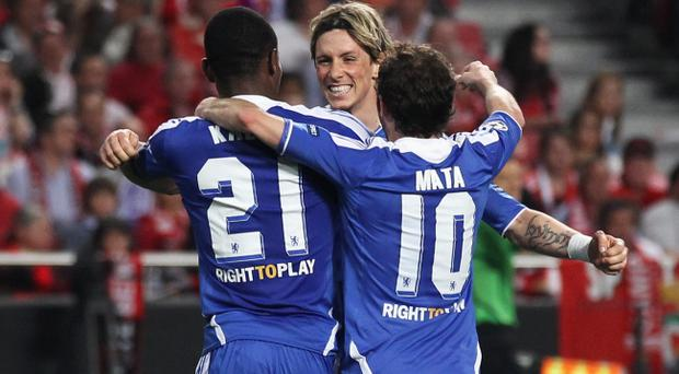 LISBON, PORTUGAL - MARCH 27: Fernando Torres and Juan Mata of Chelsea congratulate scorer Salomon Kalou after his goal during the UEFA Champions League Quarter Final first leg match between Benfica and Chelsea at Estadio da Luz on March 27, 2012 in Lisbon, Portugal. (Photo by Clive Rose/Getty Images)