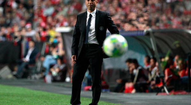 Chelsea's coach Roberto Di Matteo follows the action from the sideline during their Champions League quarter-finals soccer match with Benfica