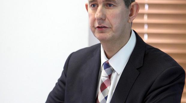 Health Minister Edwin Poots visited five Libyan men being treated at a Belfast hospital