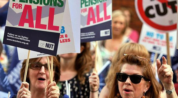 Demonstrators against the Government's public sector pension reforms protest outside the Department for Education