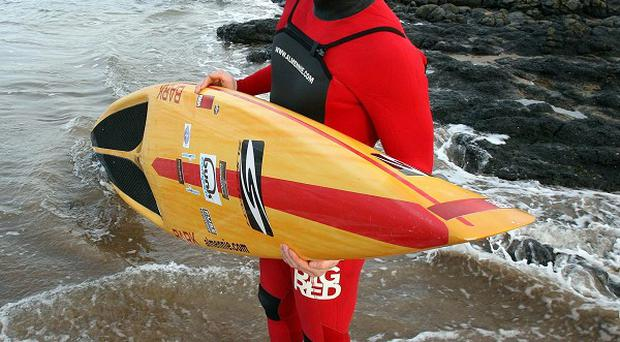 Surfer Al Mennie paddled from Ireland to Scotland to raise money for charity