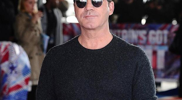 Simon Cowell said he feels 'tongue-tied' around make-up artist Francesca Neill