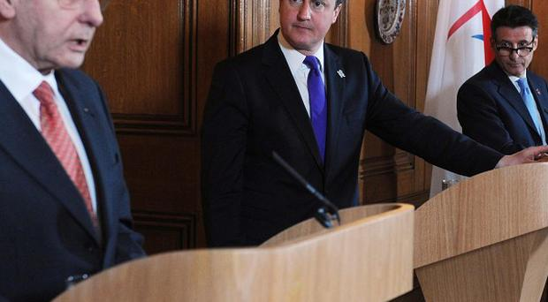 David Cameron and Lord Coe listen to IOC president Jacques Rogge, left, at 10 Downing Street