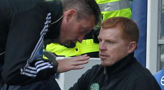 A match official speaks to Celtic manager Neil Lennon during Sunday's Old Firm derby against Rangers