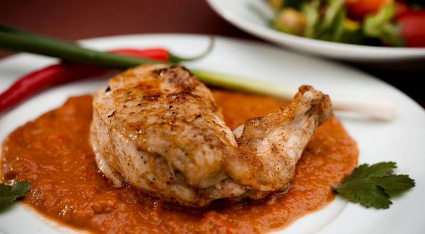 Roast chicken with mole sauce, using chocolate and chilli.