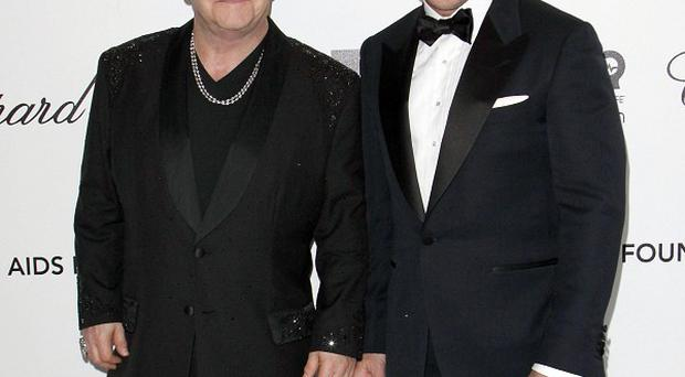 Sir Elton John and David Furnish are reportedly planning to extend their family