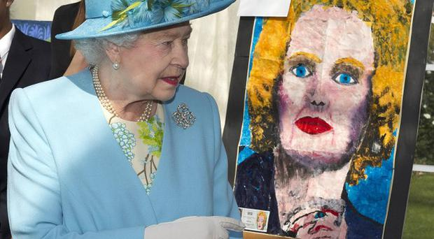 The Queen looks at a portrait of Margaret Thatcher during a visit to Valentines Park and Mansion, Redbridge (Arthur Edwards/PA Wire)