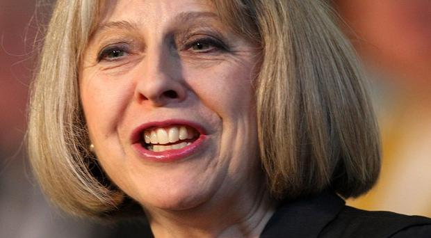 Theresa May is considering an independent review which found the UK's extradition treaty with the US was both balanced and fair