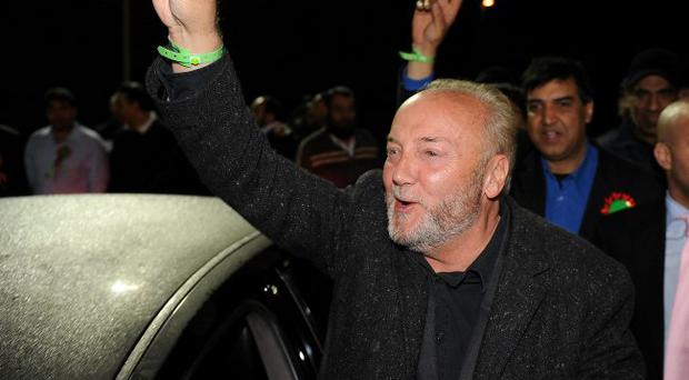 George Galloway of the Respect Party celebrates with his supporters after winning the Bradford West by-election