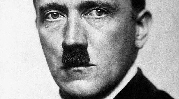 Adolf Hitler's parents' tombstone has been removed from an Austrian village because it has become a neo-Nazi pilgrimage site (PA).