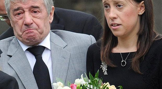Gemma Redmond, seen here at the funeral of her husband Ian, said she did not want his legacy to be 'dominated by an awful accident'