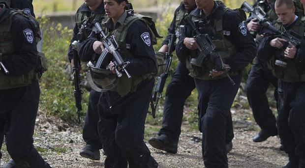 Israeli riot police near the border with Syria as security is tightened ahead of Land Day (AP)