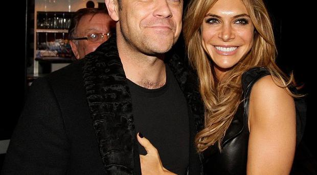 Robbie Williams with his wife Ayda
