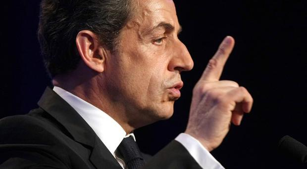 French president Nicolas Sarkozy says there will be more raids on suspected Islamist extremists (AP)