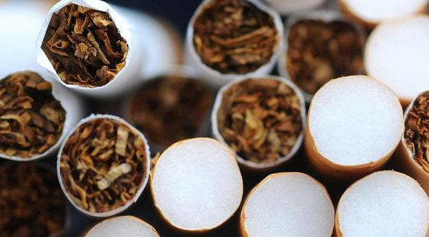 Smoking out of a window does not protect children from the harmful effects, doctors have warned