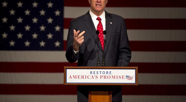 Mitt Romney addresses an audience during a campaign stop on the campus of Lawrence University in Appleton, Wisconsin (AP)