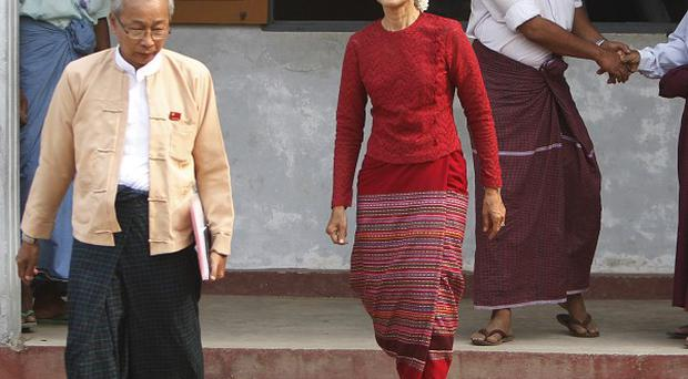 Aung San Suu Kyi leaves a polling station on the outskirts of Yangon, Burma (AP)