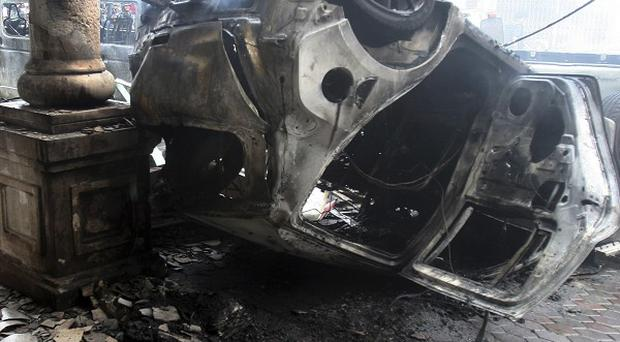 The wreckage of cars after the car bomb attack in Yala province, Southern Thailand (AP/Sumeth Panpetch)