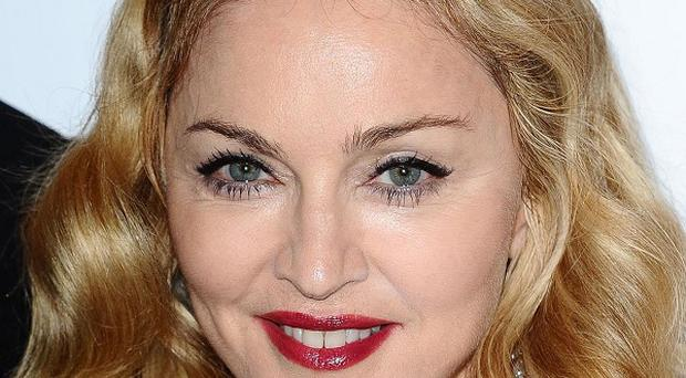 Madonna's MDNA is number one in the UK album chart