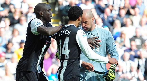 Liverpool goalkeeper Jose Reina (right) headbutts Newcastle United's James Perch during the Barclays Premier League match at the Sports Direct Arena, Newcastle