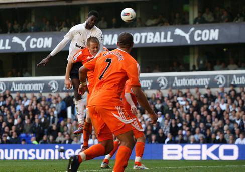 Tottenham Hotspur's Emmanuel Adebayor scores his side's third goal of the game during the Barclays Premier League match at White Hart Lane, London
