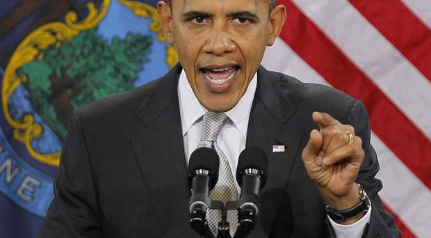 A contributor to Barack Obama's re-election effort has been accused of fraud (AP/Robert F Bukaty)