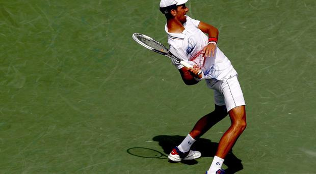 KEY BISCAYNE, FL - APRIL 01: Novak Djokovic of Serbia serves to Andy Murray of Great Britain during the final of the Sony Ericsson Open at the Crandon Park Tennis Center on April 1, 2012 in Key Biscayne, Florida. (Photo by Matthew Stockman/Getty Images)