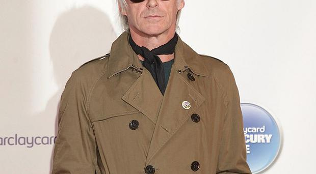 Paul Weller became dad to twins John-Paul and Bowie iin January