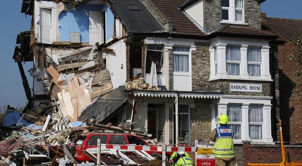 Rescue workers survey the scene of an explosion in Wellesley Road, Clacton, Essex