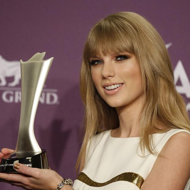 Taylor Swift was named entertainer of the year at the Annual Academy of Country Music Awards