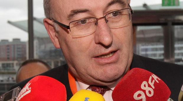 Phil Hogan is embroiled in a dispute over management fees at his apartment in Portugal