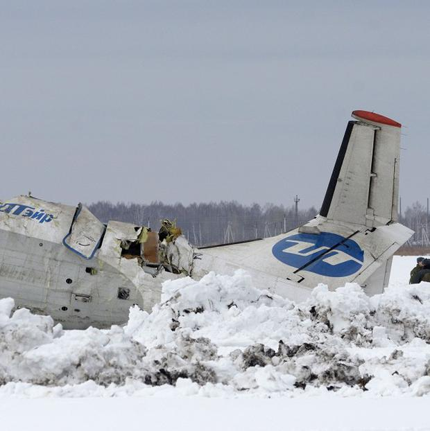 Rescue workers examine the wreckage of an ATR-72 plane near Tyumen in Siberia (AP)