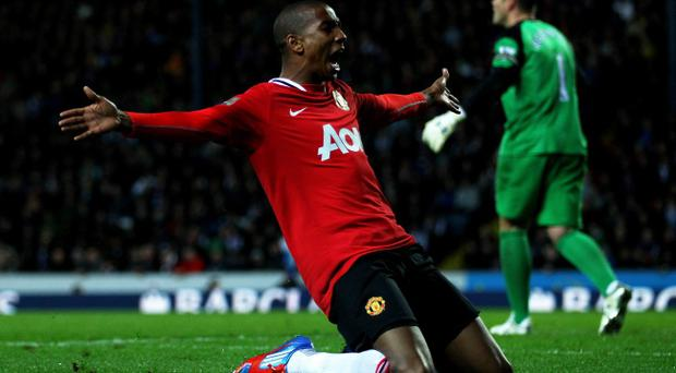BLACKBURN, ENGLAND - APRIL 02: Ashley Young of Manchester United celebrates scoring his team's second goal during the Barclays Premier League match between Blackburn Rovers and Manchester United at Ewood Park on April 2, 2012 in Blackburn, England. (Photo by Clive Brunskill/Getty Images)