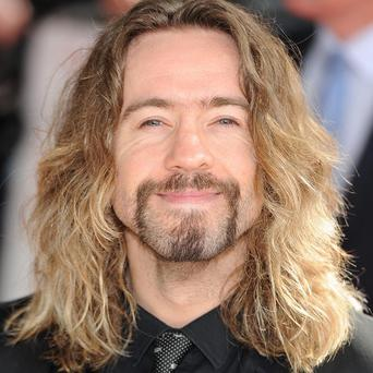 Justin Lee Collins is to stand trial for allegedly harassing his former girlfriend